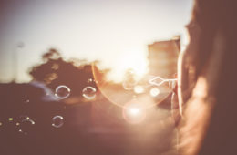 girl blowing bubbles in the sunset evening picjumbo com