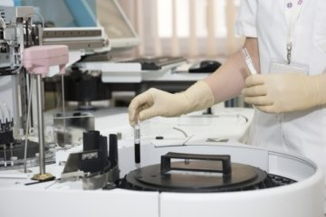 doctor preparing lab material for tests