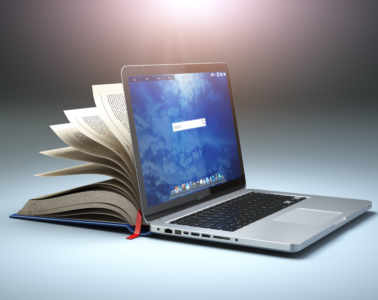 Online Library Or E Learning Concept. Open Laptop And Book Compilation.